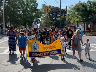 Ed Smith students, teachers, and families in the Westcott Cultural Fair parade